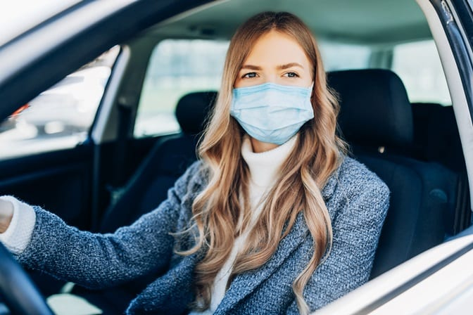 Woman in mask at curbside appointment