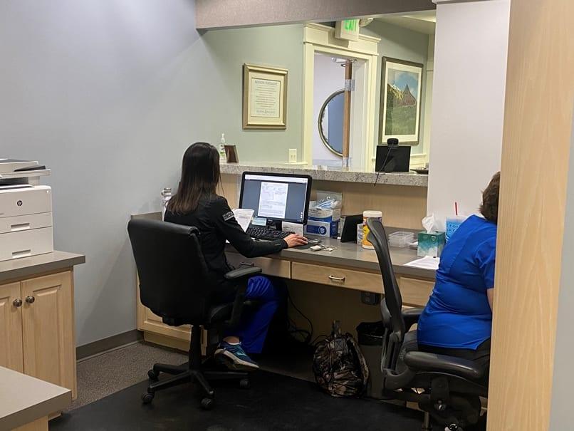 lady at reception desk